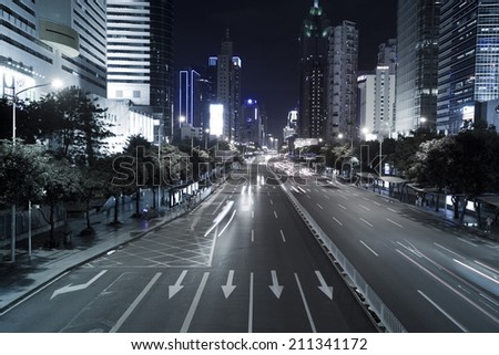 SHENZHEN, CHINA - JULY 14 : Hi-rise building and vehicles commute at night time on July 14,2014 in Shenzhen, China. Shenzhen is China\'s financial center and first\'s special economic zone.