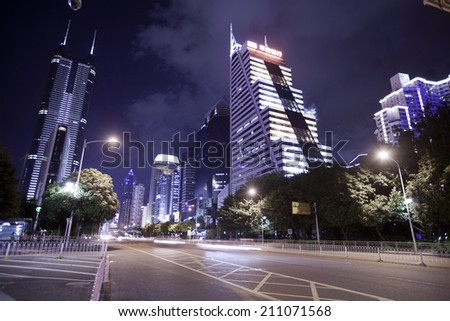 SHENZHEN, CHINA - JULY 14 : Hi-rise building in city center at night time on July 14,2014 in Shenzhen,China. Shenzhen is China\'s financial center and first\'s  special economic zone.