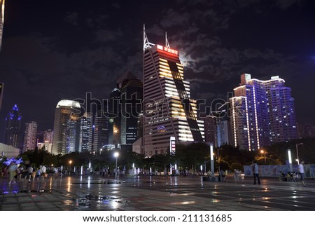 SHENZHEN, CHINA - JULY 14 : Hi-rise building in city center at night time on July 14,2014 in Shenzhen, China. Shenzhen is China\'s financial center and first\'s special economic zone.