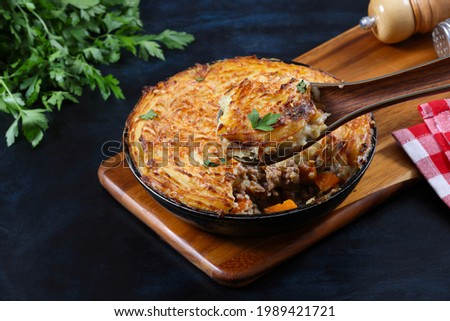 Shepherd's pie, cottage pie, or hachis Parmentier, is a ground beef meat pie with a crust or topping of mashed potato garnished with cheese. It is most likely of English origin.