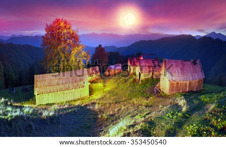 shepherds leave the pasture before the first snow and frost deserted house asylum sheds remain until next season, against the background of gold and red peaks of the Carpathians