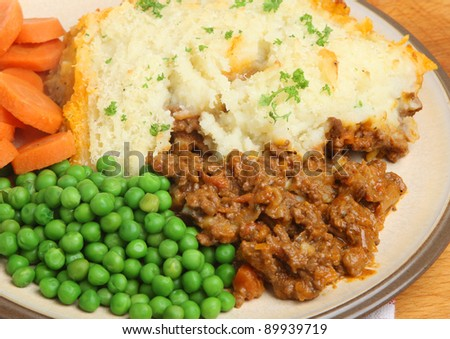 Shepherds pie with peas and carrots.