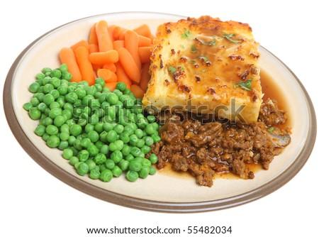 Shepherds pie with peas, carrots and gravy.