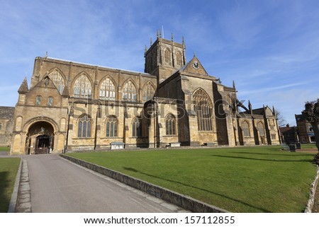 Sherborne Abbey is the Abbey Church of St Mary the Virgin in the English county of Dorset UK Blue sky behind