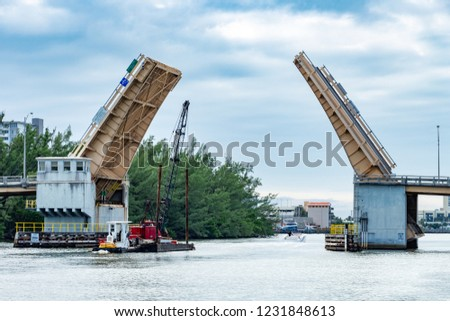 Sheridan Street double-leaf bascule bridge opens to allow a vessel through - Hollywood, Florida, USA