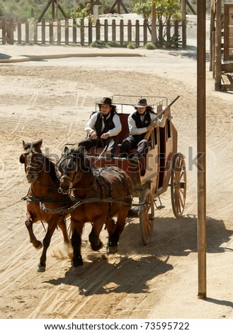 Sheriff and Deputy driving a stagecoach at Mini Hollywood, Almeria, Andalusia, spain - stock photo