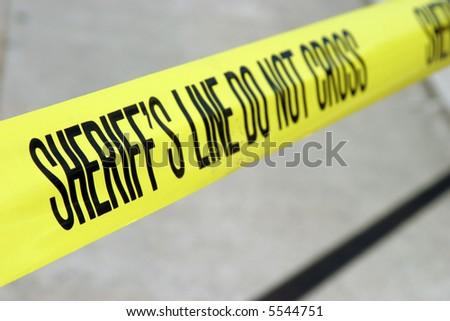 sheriff line do not cross yellow tape - Shutterstock ID 5544751