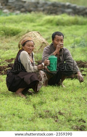 Sherpa Couple Resting From Farming