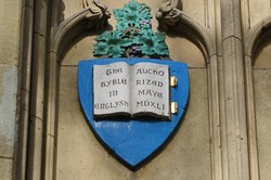 shield representing Cranmer's bible on the Martyrs' memorial in St Giles' Oxford built in 1838 in memory of 16th century protestant bishops translation is The Bible in English Authorised May 1541