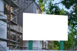 shield sign with information about object at construction site on city street building background, mock-up
