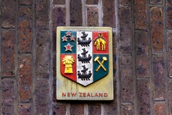 Shield with the insignia of New Zealand repreenting trade, agriculture and industry