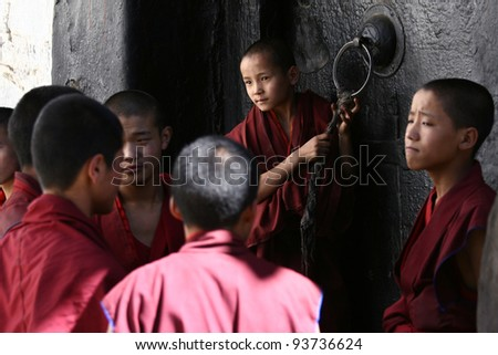 SHIGATSE, TIBET- JUNE 5: Unidentified monks debate in the Tashilunpo monastery area on June5, 2010 in Shigatse, Tibet. Debating is part of the monastery curriculum to become a higher lama.