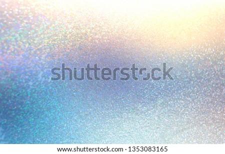 Shimmer abstract pattern. Yellow blue cristals background. Spectrum light stroke. Brilliance glitz texture. Diamond bright sparkles illustration. Winter holiday iridescent backdrop. Glitter decor.