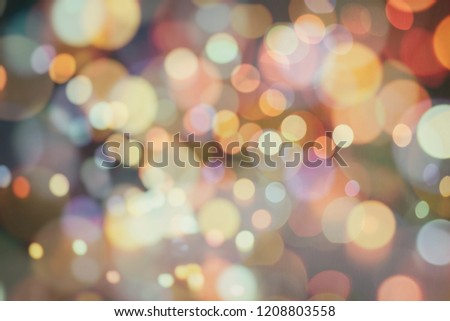 shine bulbs lights background:blur of Christmas wallpaper decorations concept.holiday festival backdrop:sparkle circle lit celebrations display. #1208803558