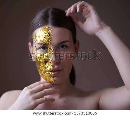 Shine, shine like a star. Beauty girl with golden glitter on face. Close up. #1373310086