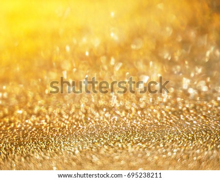 Shines in shades of golden background #695238211