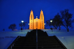 Shining Akureyrarkirkja church in the winter night, Akureyri, North  Iceland