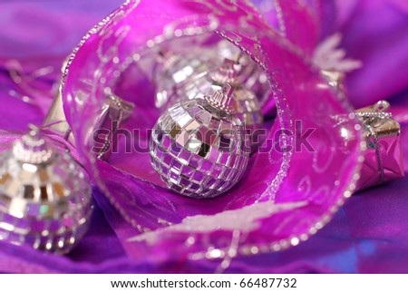 shining christmas  balls and ribbon in pink and purple colors