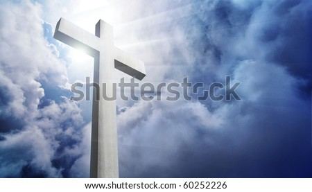 shining cross against dramatic cloudy sky