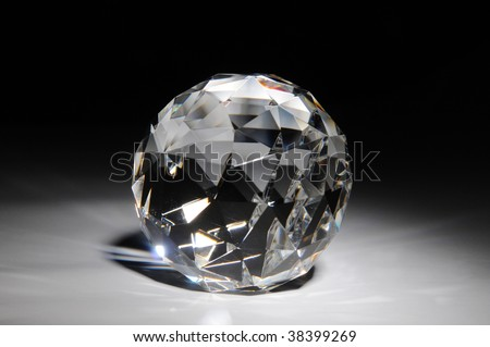 Shining crystal round shape on gradient black and white background
