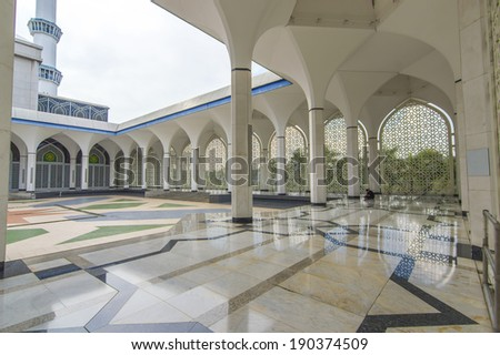 Shining floor marble reflection at mosque corridor