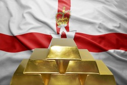 shining golden bullions on the northern ireland flag background