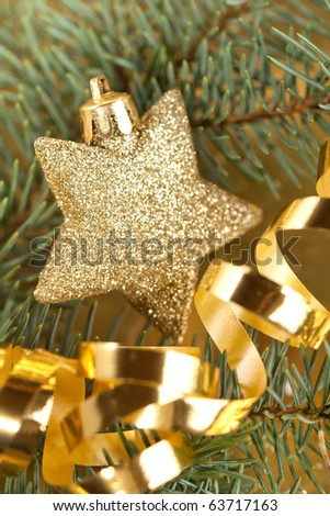 Shining golden christmas star with christmas tree and golden tape