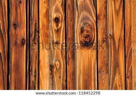 Shining plank of wood - background