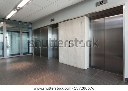 Shining silver elevator in a modern office building