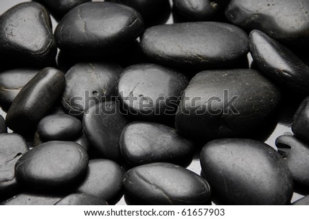 Shining smooth natural black stones - stock photo