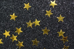 Shining stars amidst a glittering background / Golden stars / Symbolic signs of success
