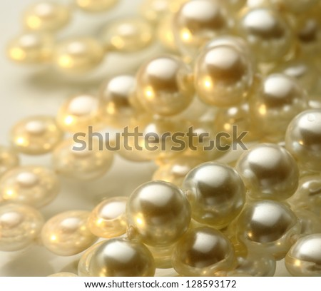 Shining string of white pearl in water - stock photo