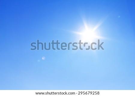 Shining sun at clear blue sky. - Shutterstock ID 295679258