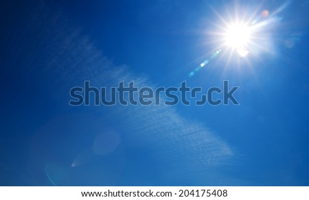 Shining sun at clear blue sky with copy space #204175408
