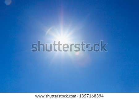 shining sun at clear on blue sky background with a copy space #1357168394
