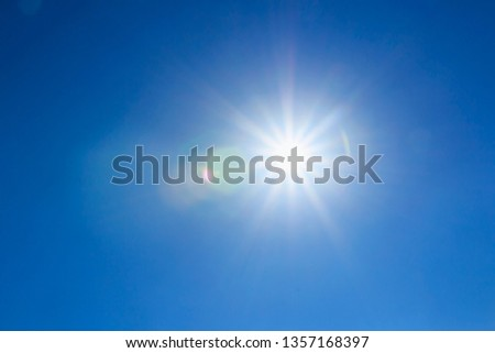 shining sun at clear on blue sky background with a copy space #1357168397