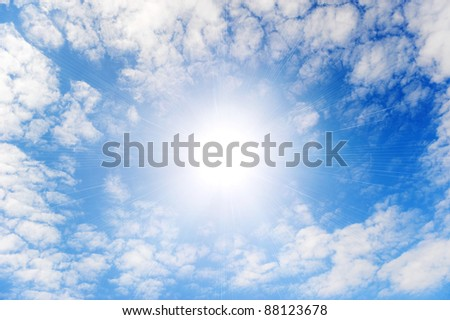 Shining sun with beams in the centre of clouds.Small wavy clouds