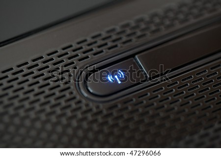 shining wifi button on computer - stock photo