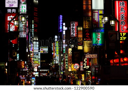 SHINJUKU, JAPAN- OCTOBER 16, 2012: Kabuki-cho is red-light district well known for its bars,restaurants and nightclubs establishments in major commercial center of Tokyo, Japan. October 16 2012