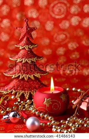 Shinny christmas postcard with burning candle, christmas tree, and shinny decorations