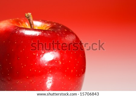 Shinny red apple on red gradient background