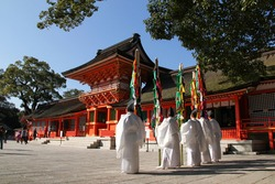 Shinto priests are waiting for the Buddhist monks in front of the main shrine. Chinekisai festival, Usa shrine, Oita prefecture, Kyushu, Japan.