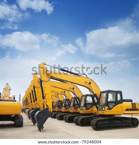 shiny and modern yellow excavator machines