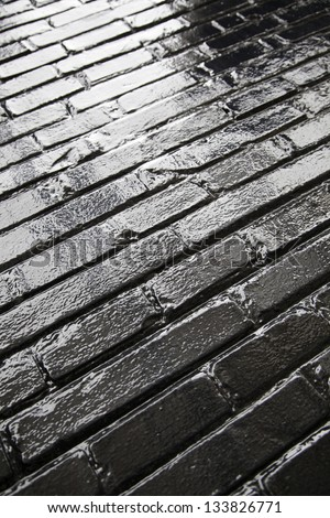 Shiny black floor, black ground detail in the bright city background with texture and shine
