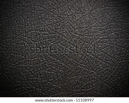 shiny black leather background close up
