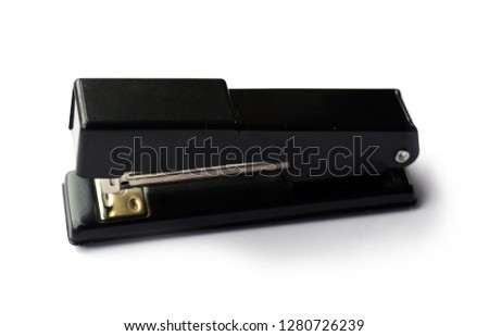 Shiny black metal stapler - isolated.  School or office supplies.