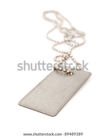 Shiny Blank Metallic Military Identification Plate on White Background With Shadow - Shallow Depth of Field