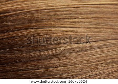 Shiny brown hair close-up background