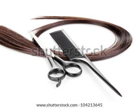 Shiny brown hair with hair cutting shears and comb isolated on white