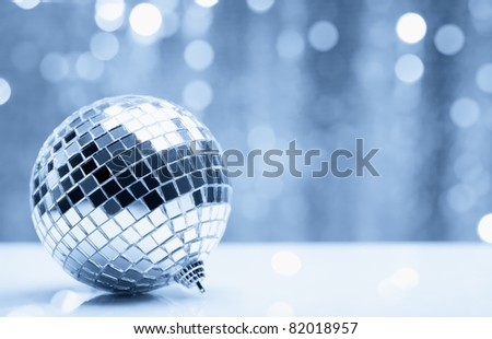 Shiny christmas ball over blurry background. Shallow Dof.